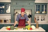 Man Chef Cook In Kitchen, Cuisine. Vegetables And Tools On Table Ready For Cooking. Food Preparation poster