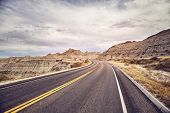 Scenic Road In Badlands National Park, Color Toned Picture, South Dakota, Usa. poster