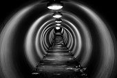 Grungy Tunnel At Night With Circular Light Patterns