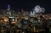 Oakland And San Francisco Downtowns With New Years Eve 2019 Fireworks. Oakland Hills, Alameda County poster