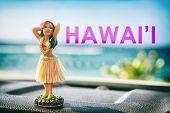 Hawaii hula dancer girl doll on dashboard of car road trip - summer vacation travel dancing woman at poster