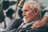 Cropped View Of Retired Wife Embrace Sad Senior Husband At Home poster