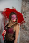 Portrait Of A Beautiful Young Woman, With Venetian Carnival Red Mask, With Red Umbrella. Glamor Girl poster