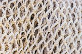 Close-up Of Commercial Fishing Net At Harbor    Fisher, Net, Maritime, Background, Texture, Backgrou poster