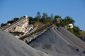 picture of sand gravel  - Conveyor belts with piles of gravel at stone quarry - JPG