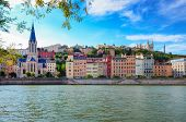 Lyon Cityscape From Saone River With Colorful Houses And River