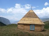 foto of yurt  - Yurt on the mountains with blue sky and clouds background - JPG