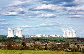 view of nuclear power plant and spring time village - life neat the nuclear plant