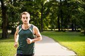 Jogging - man running in nature