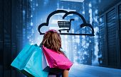 stock photo of cart  - Woman in a data center holding shopping bags and looking at a drawing with a shopping cart into a cloud - JPG