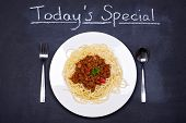 Chalkboard advertising the daily special of Spaghetti Bolognese