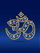 Om Symbol In Gold With Sapphire Stones