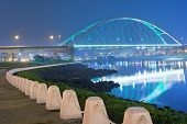 City night scene with illuminated bridge over river in Taipei, Taiwan, Asia. The bridge was named Ma