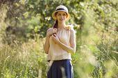 Beautiful Happy Woman Among The Tall Grass