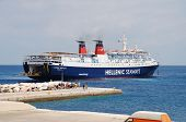 ALONISSOS, GREECE - JUNE 26: Hellenic Seaways ferry Express Pegasus docking at Patitiri harbour on June 26, 2013 on the Greek island of Alonissos. The 125.7 mtr long ship was built in 1977 in Italy.
