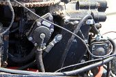pic of outboard engine  - Old Disassembled Boat Outboard Motor on a sandy beach - JPG