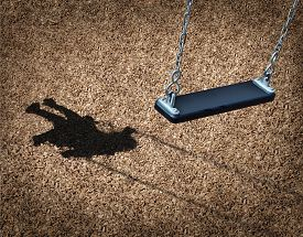 foto of runaway  - Missing child concept with an empty playground swing and the shadow of a little girl on the park floor as a symbol of children losing their childhood and being lost as in a failed adoption or youth despair caused by family violence - JPG