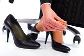 stock photo of disadvantage  - Wearing high heel shoes has its painful disadvantages  - JPG