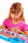 Little Girl Playing Piano Keyboard