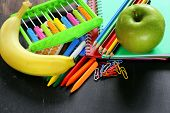 Back to school concept, school stationery multicolored pencils and notebooks