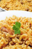 closeup of a plate with fideos a la cazuela, spanish noodles with chicken or pork