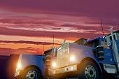 stock photo of semi trailer  - Two American Large Semi Trucks in Sunset Illustration - JPG