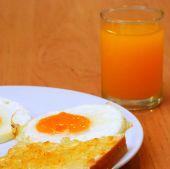 Fried egg with jam toast and orange juice