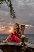 Thai girl with long tailed boat on the beach