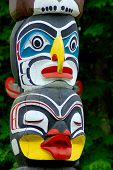stock photo of indian totem pole  - Totem poles are monumental sculptures carved from large trees - JPG