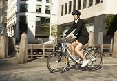 Businesswoman cycling to work