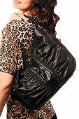 Closeup of woman with brown black bag wearing leopard top. Isolated on the white studio background