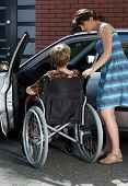 Disabled And Daughter Next To Car