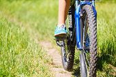 Closeup  Woman Riding Mountain Bike Outdoors.