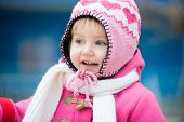 smiling little girl in winter
