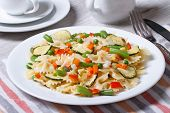 Farfalle Pasta With Slices Of Vegetables, Cheese Closeup