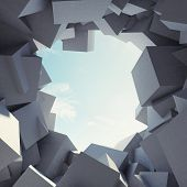Abstract tunnel to sunlight made of concrete cubes