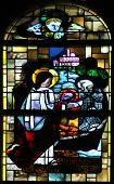 PARIS, FRANCE - NOV 05,2012: Vocation of St Andrew, stained glass in Church of St Eustace. Church wa