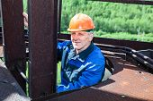 Senior Worker Climbing Up For Maintenance Works
