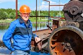 Engineer Worker Standing Near Sewage Treatment Mechanism