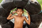 BUKIT LAWANG,INDONESIA, July 06 : Unidentified little boy holding a air tube for tubing in the river