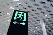 SHENZHEN - APRIL 16: exit sign in airport on April 16, 2014 in Shenzhen, China. Shenzhen Bao'an Inte
