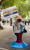 Elaborately Dressed Man With Placard