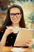 Young Woman with Glasses and Tablet Having Coffee