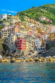 Riomaggiore in Cinque Terre, Italy, view at the town from mountain trail