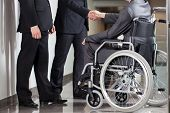 Handshake Between Disabled Man And Boss