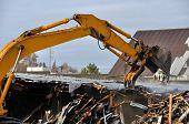 loader demolishes an old building