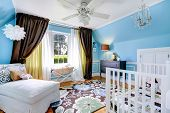 picture of settee  - Bright cheerful nursery room interior with blue walls and hardwood floor - JPG