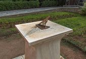 picture of sundial  - Sun clock marble sundial in National Garden of Athens photo - JPG