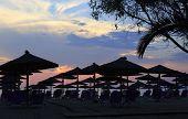 Sunset on beach of Aegean Sea.