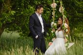 picture of swing  - Beautiful couple bride and groom in wedding suit enjoy moments of happiness - JPG